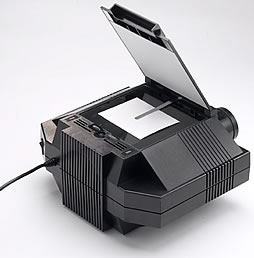 The Prism Digital Art Projector from Artograph as viewed from the back, with the door up to view the copy area.